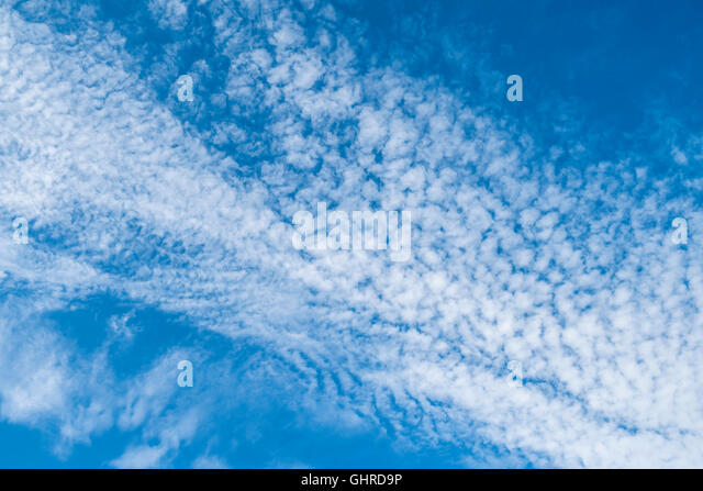 Blue sky with mottled cirrocumulus high clouds - France. - Stock Image