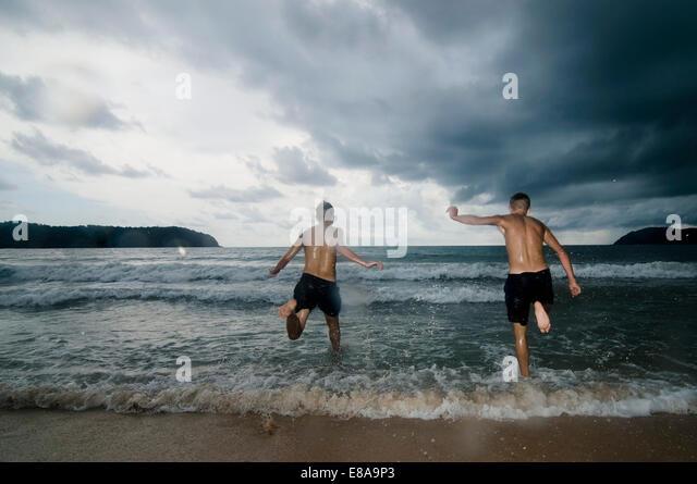 two boys at ocean, Lankawi, Malaysia - Stock Image
