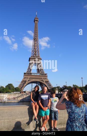 Paris France Europe French Seine River Pont d'Iéna Jena Bridge Eiffel Tower pedestrians taking picture - Stock Image
