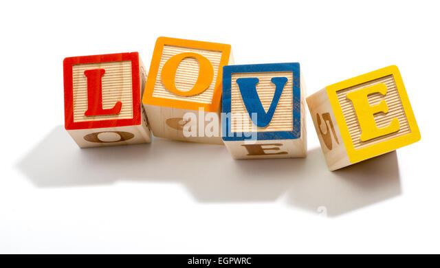 Love in Colored Wooden Letter Blocks - Stock Image