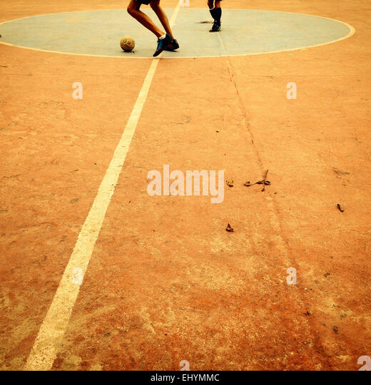 Boys playing football - Stock Image