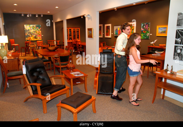 Maine Freeport Main Street Thomas Moser Cabinetmakers hand-crafted designer furniture chairs tables man woman couple - Stock Image