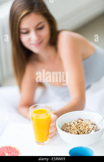 Woman having breakfast. - Stock-Bilder