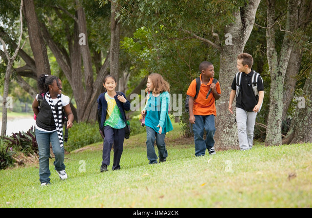 Fort Lauderdale, Florida, United States Of America; A Group Of Preteen Students Walking Together - Stock Image