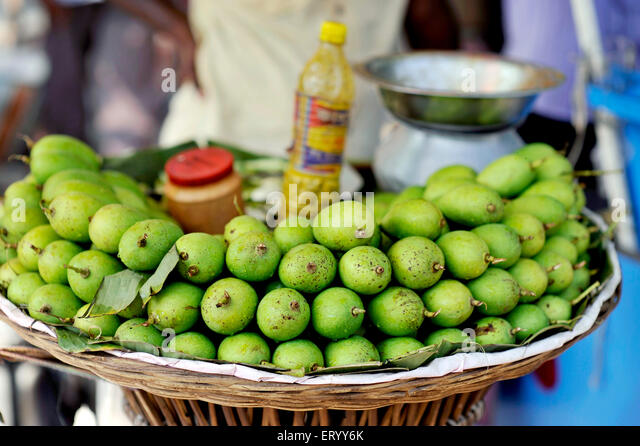 The green mangoes to overcome summer heat in the Sunday Market in Kolkata India - Stock Image