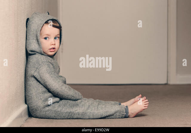 Cute Child in Onesie - Stock Image