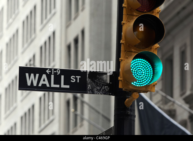 The Wall street area in New York City's financial district houses the New York Stock Exchange. - Stock Image
