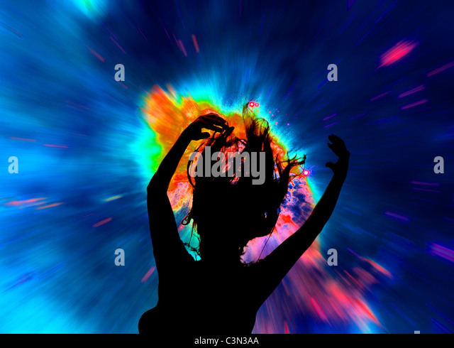 silhouette of  teen-age girl at Rave dance concert - Stock Image