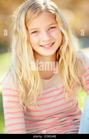 Portrait Of Pretty Girl In Countryside - Stock Image