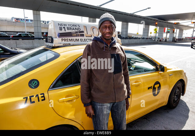 New York City NY NYC Queens Black man taxi cab driver John F. Kennedy International Airport - Stock Image