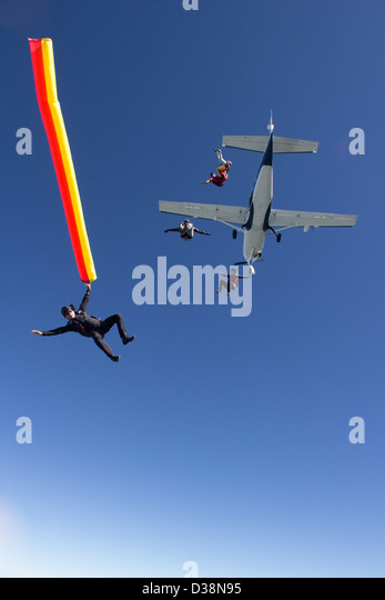 People skydiving from plane - Stock Image