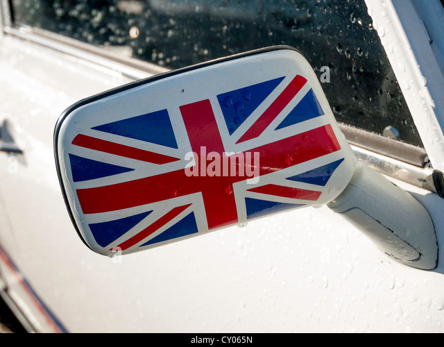 Close up of a wing mirror painted with a Union Flag on an historic 1993 white BMC  Mini 1275 motor car - Stock Image