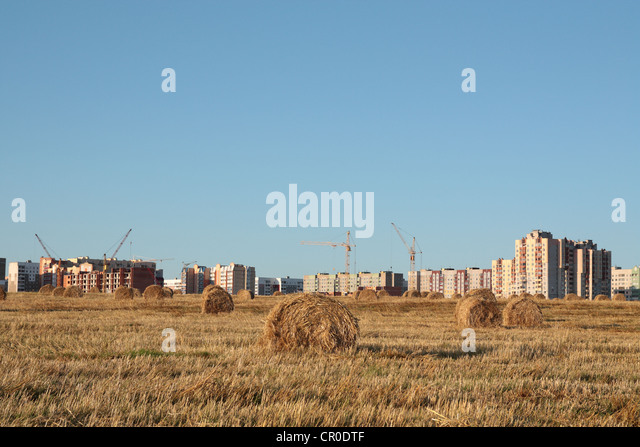City approaching for field - Stock Image