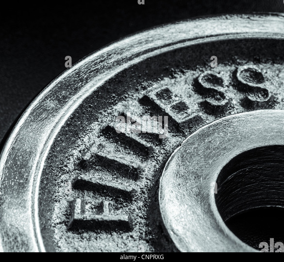 Iron text of the word fitness - Stock Image