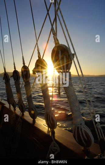 Sailing Schooner mast stays Whitsunday Islands Queensland Australia at sunset - Stock Image