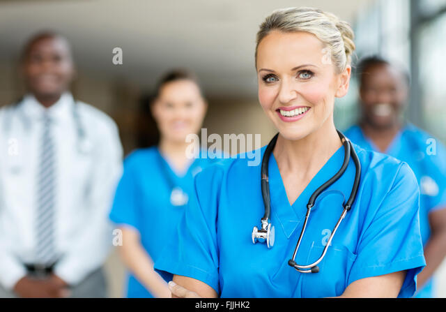 group of medical workers in hospital - Stock Image