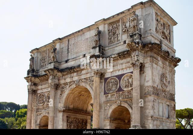 View of Arco di Costantino in sunny weather in Rome. A 21m high Roman structure made up of 3 arches decorated with - Stock Image