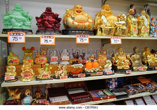San Francisco California Chinatown Grant Street shopping Oriental gift shop store retail display shelf ceramic figurine - Stock Image