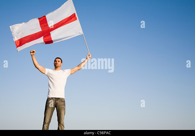 Man holding St George's Cross flag air - Stock Image