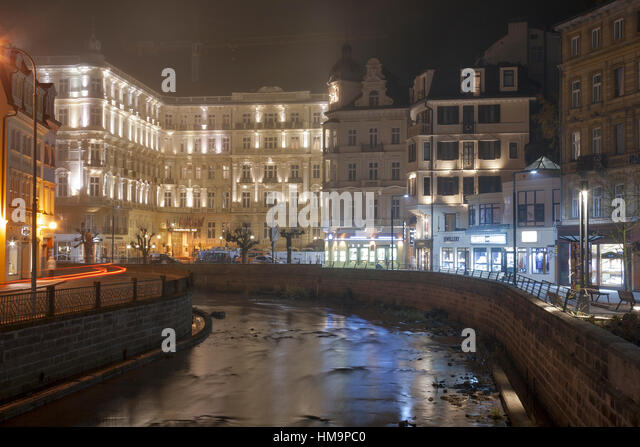 KARLOVY VARY, CZECH REPUBLIC - NOVEMBER 13: Night facade of luxury spa GrandHotel Pupp and river Tepla on November - Stock-Bilder