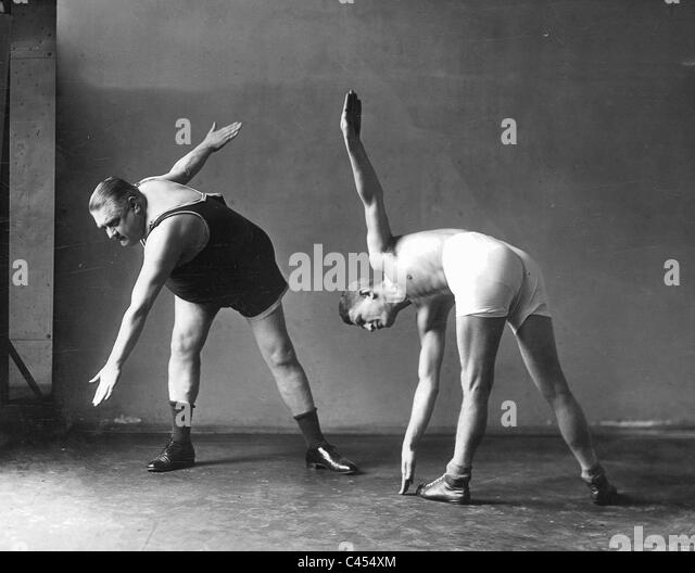 Two men at the gymnastics, 1926 - Stock Image