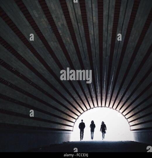 Full Length Of People Walking In Tunnel - Stock Image