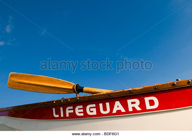 A  traditional red and white lifeboat. - Stock Image