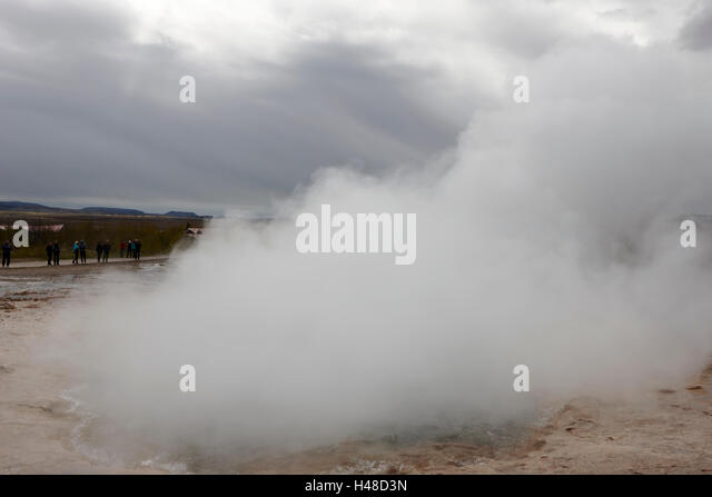 steam rising from the strokkur geyser geysir Iceland - Stock Image