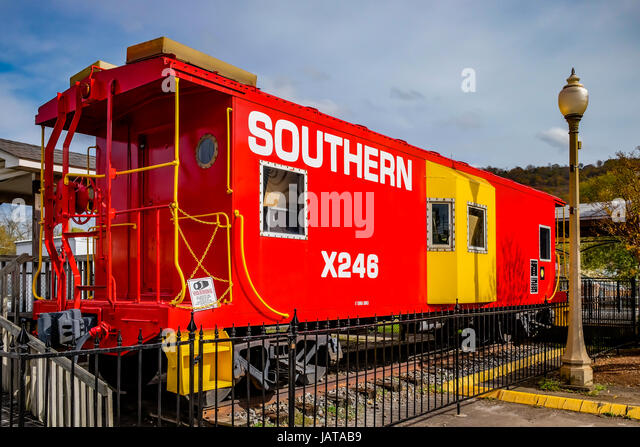 Restored Southern Railroad caboose on static display at the Fort Payne, Alabama, historic train station. - Stock Image