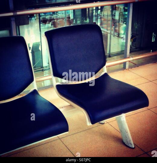 Empty seats at the departure gate - Stock Image