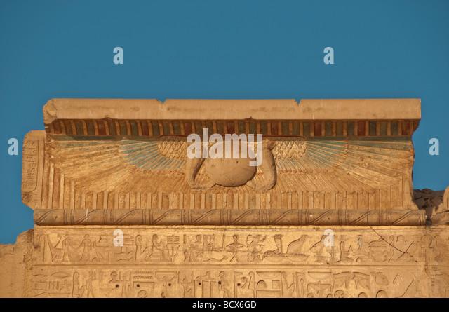 Egypt Kom Ombo Temple winged globe, serpent heads and hieroglyphics - Stock Image