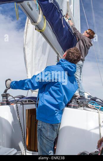 Father and son (men) sailing around Majorka - Stock Image