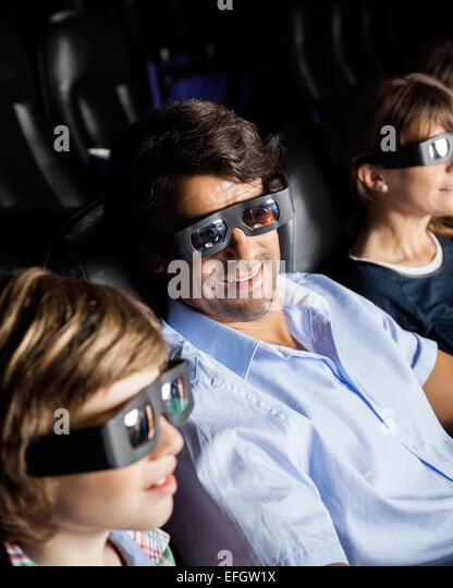 Family Watching 3D Movie In Theater - Stock Image