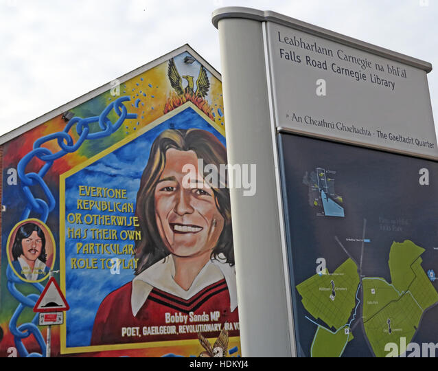 Belfast Falls Rd Rebublican Bobby Sands Mural and Carnegie Library - Stock Image
