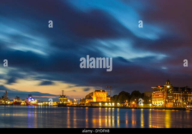 Moving clouds over Bergen harbour. - Stock Image