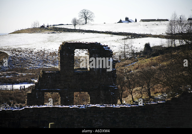 Facade of Cheesden Lumb Lower Mill in the Cheesden Valley landscape near Heywood Lancashire UK - Stock Image