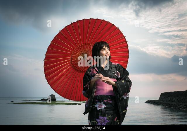 Japanese woman in Kimono and traditional umbrella - Stock Image