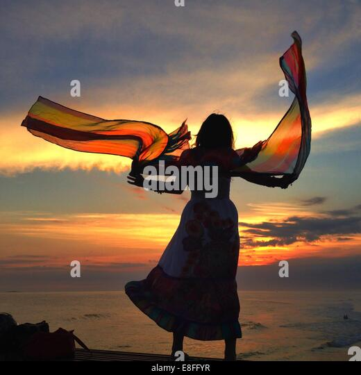 Woman with floaty scarf - Stock Image