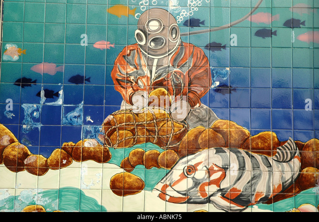 Tarpon Springs FL Wall Tiles at the Sponge Exchange showing traditional sponge hard hat diver - Stock Image