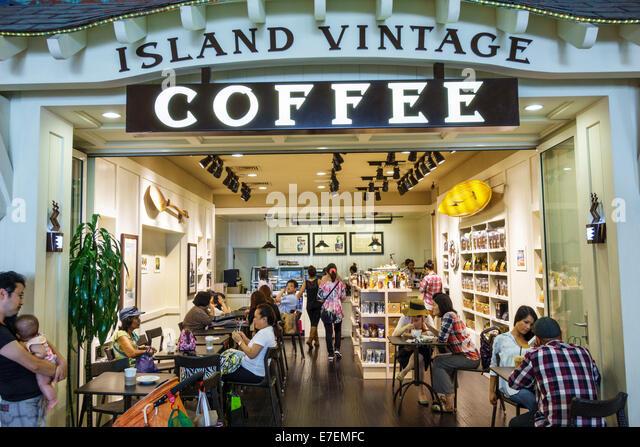 Hawaii Oahu Hawaiian Honolulu Ala Moana Center centre mall Island Vintage Coffee cafe front entrance - Stock Image