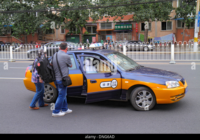 China Beijing Dongzhimen taxi cab passengers entering - Stock Image