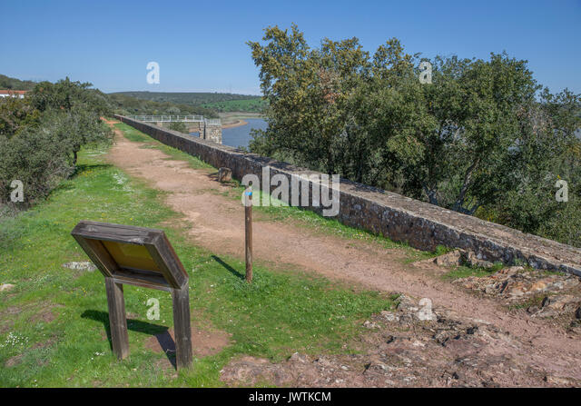 Overlooking at Dam of Cornalvo Reservoir from top of the wall. This dam was declared National Monument on Dec 13th - Stock Image