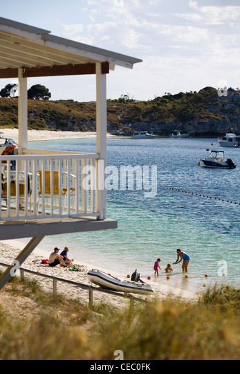 Family enjoying time on the beach at Geordie Bay - a popular holiday location on Rottnest Island, Western Australia, - Stock-Bilder