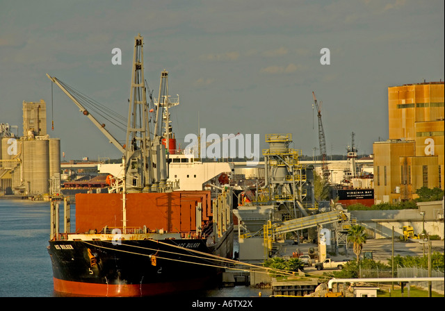 Tampa Bay Florida  Port of Tampa red cargo ship at dock open space text space copy space type space - Stock Image
