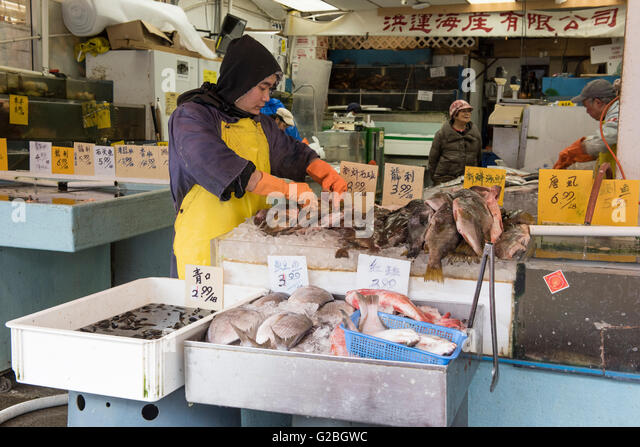 Fish monger stock photos fish monger stock images alamy for Chinatown fish market
