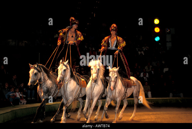 Moscow Russia New Circus Performers Standing on Horses - Stock Image