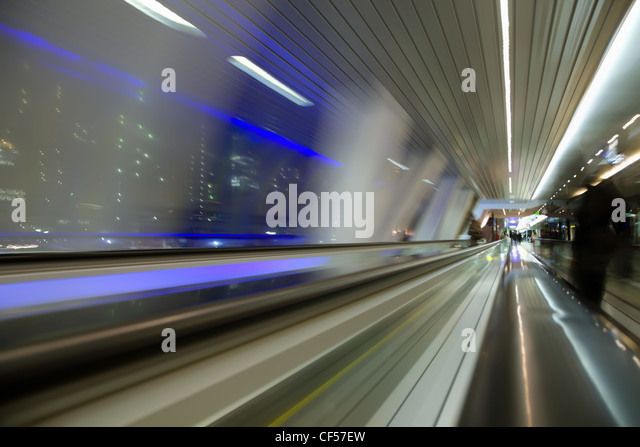 blured abstract view from window in long corridor in modern building on night city - Stock Image