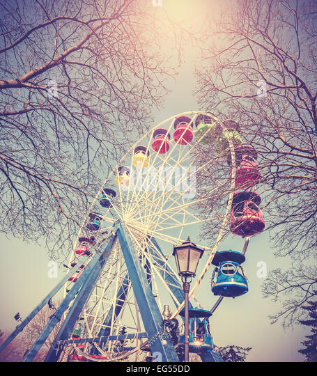 Retro vintage filtered picture of ferris wheel in a park. - Stock Image