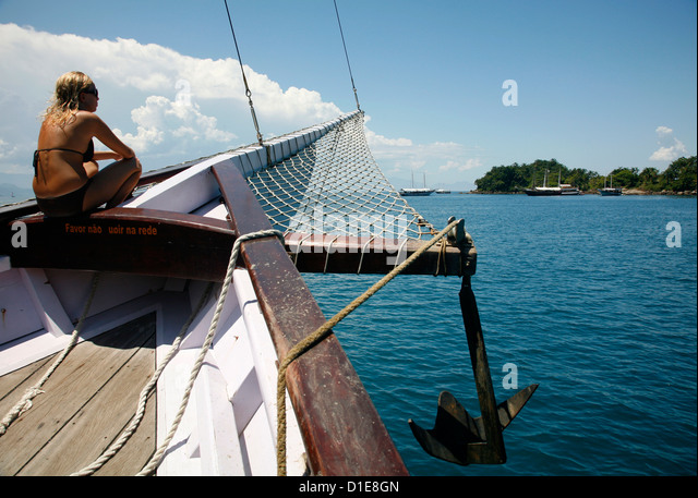 Tourist on a schooner cruising between the different beaches and islands around Parati, Rio de Janeiro State, Brazil - Stock Image