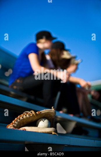 Spectators at a baseball game - Stock Image